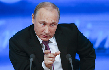 Russian President Putin speaks during his annual end-of-year news conference in Moscow